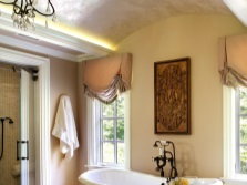 Wrought iron chandelier in the bathroom in the style of Provence