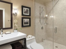 Beige bathroom with black furniture