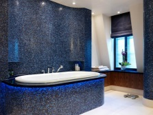 Dark blue bathroom with mosaic