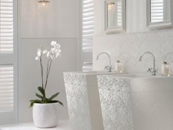 Furniture in white bathroom with an unusual texture