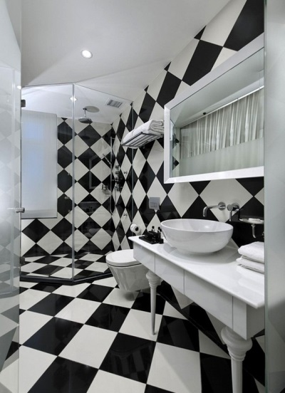 White and black bathroom with a checkerboard pattern
