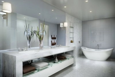 White and gray bathroom with spot lights