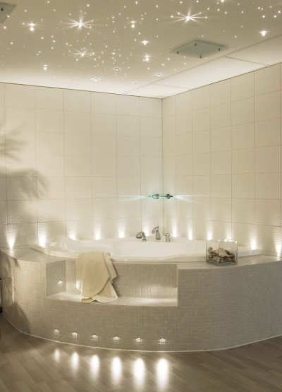 A well-lit white bathroom