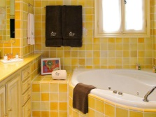 Yellow bathroom with mosaic