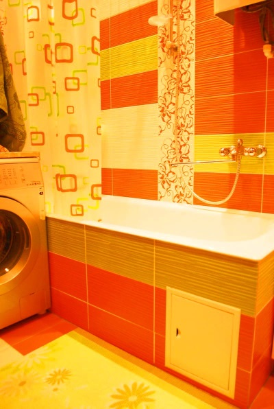Yellow- red orange bathroom