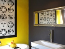 Yellow and black wall in the bathroom
