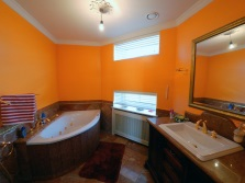 Orange bathroom with white sanitary ware