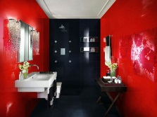 Red and black bathroom with white sanitary ware
