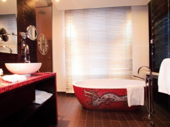 Red bathroom with a Japanese dragon pattern
