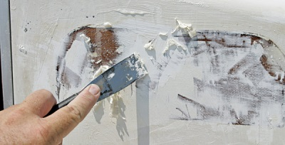 Removing paint with a chisel