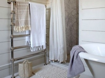 Lower water heated towel rail in the bathroom with towels - dignity