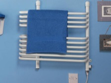 Combined white towel warmer in the bathroom