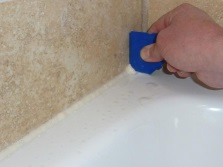 Filling the gaps between the tub and the wall by using a sealant