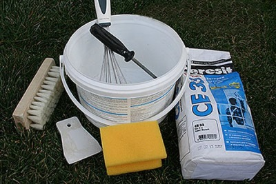 Materials and tools for grouting between the tiles