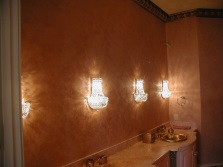 Decorative plaster walls in the design of the bathroom