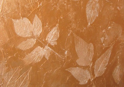 Decorative relief plaster effect of the golden glow