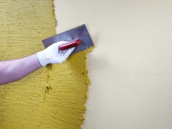 Application textured plaster on the painted wall