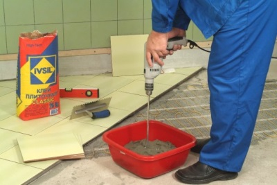 Tile adhesive with mixing