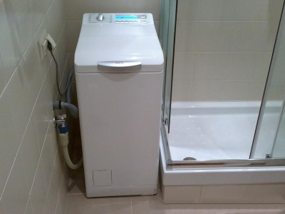 Washing machine with top-loading in the bathroom - which machine smaller jumps and vibrates