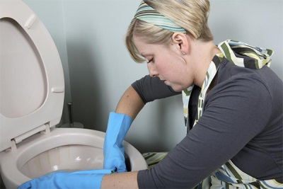The process of cleaning toilets