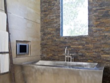 Design a bathroom with bath , stainless steel