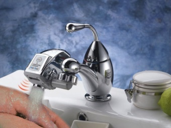 The sensor head on the faucet to save water in the bathroom