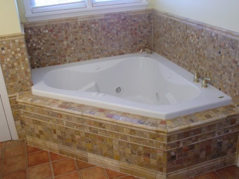 Features screens under the bathroom tiles