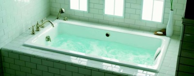 A cast iron bath with whirlpool