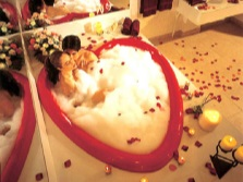 Bath for two with rose petals