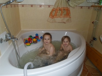 Children in the bathroom with hydro-massage mat