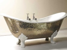 The original cast iron tub with mirrored mosaics