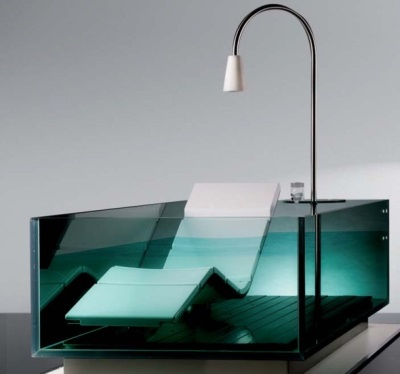 Glass bath with sunbed