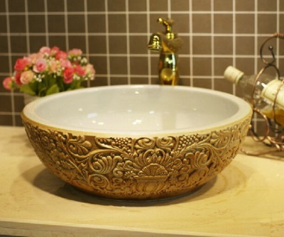 Round wash basin with gold ornaments outside the bowl width 55 cm