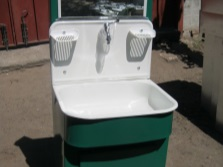 Suburban washbasin manufacturer Moidodyr with heated water