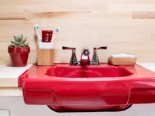 Red hanging porcelain washbasin