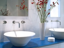 White washbasin in a blue bathroom