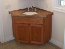 Built-in washbasin in a corner cabinet wood