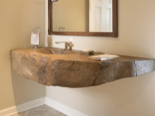 Hanging washbasin in natural stone in the bathroom