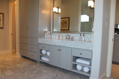 Large stone washbasin built- in furniture gray bathroom
