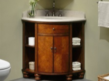 Corner cabinet with a sink in the bathroom