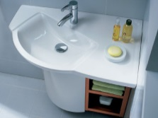 Corner sink with cupboard in the bathroom