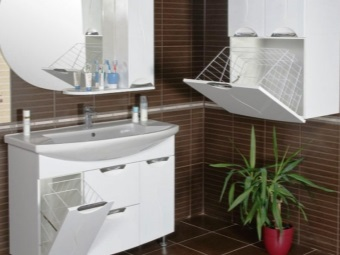 Sink with pedestal and built in laundry basket in the bathroom