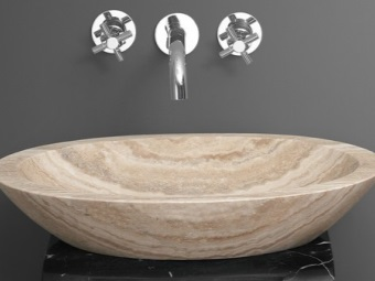 Washbasins in natural stone travertine