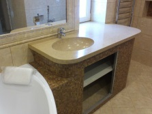 The interior of the bathroom with a sink made ​​of artificial stone
