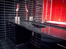 The design of the bathroom with a sink made ​​of artificial stone