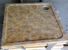 The pallet is made ​​of artificial stone for a shower with massage jets