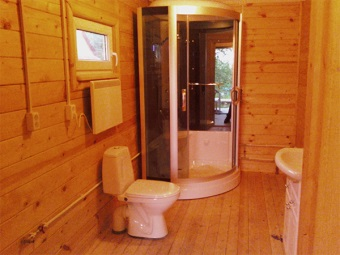 Shower in the bathroom in a wooden house