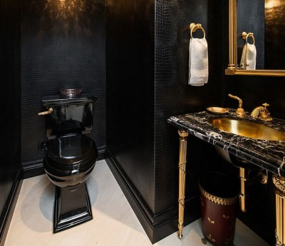 Features bathroom design with a black toilet