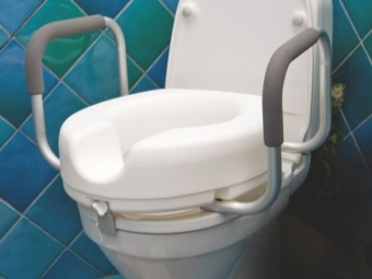 Strap on the toilet for disabled people with handrails