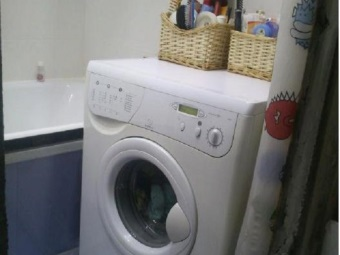 narrow washing machine as a bedside table